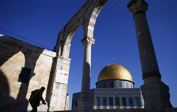 A man climbs the steps leading to the Dome of the Rock in Jerusalem's Old City