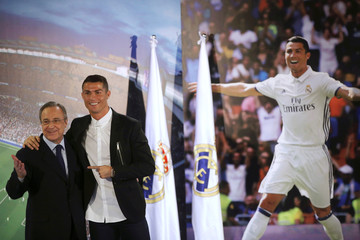 Real Madrid's Cristiano Ronaldo poses with club's president Florentino Perez after a ceremony at Santiago Bernabeu stadium in Madrid