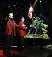 Barber and Hamner present a sculpture that represents the raising of the US flag on the island of Iwo Jima during World War Two in Branson, Missouri