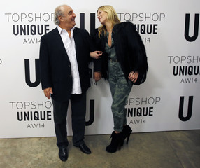 Philip Green and former model Kate Moss pose for photographs before the Topshop Unique Autumn/Winter 2014 catwalk show during London Fashion Week