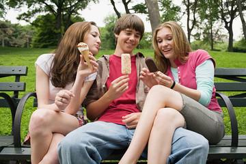 Three teenagers eating ice cream