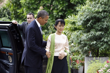 U.S. President Barack Obama and Myanmar's opposition leader Aung San Suu Kyi shakes hands during their meeting at her home in Yangon