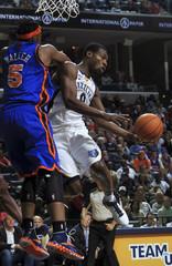Memphis Grizzlies Allen passes under the basket defended by New York Knicks Walker in Memphis