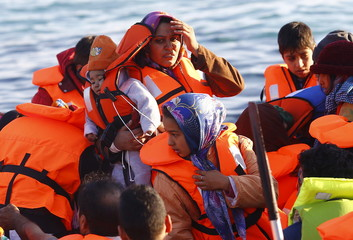 Refugees aboard a dinghy sail off for the Greek island of Chios as they try to travel from the western Turkish coastal town of Cesme, in Izmir province, Turkey