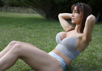 sexy brunette doing crunches outdoor