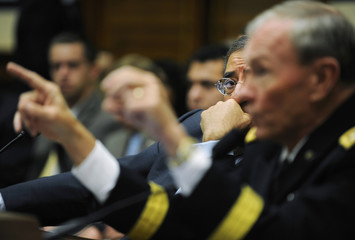 Panetta listens to Dempsey testify before the House Armed Services Committee on Capitol Hill in Washington