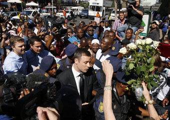 South African Olympic and Paralympic sprinter Pistorius arrives for his sentencing at the North Gauteng High Court in Pretoria