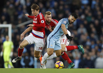 Manchester City's Sergio Aguero in action with Middlesbrough's Marten de Roon and Calum Chambers