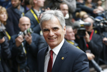 Austrian Chancellor Faymann arrives at a European Union leaders extraordinary summit on the migrant crisis, in Brussels