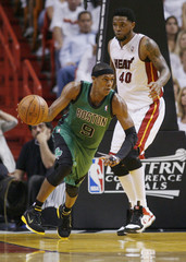 Boston Celtics' Rondo drives past Miami Heat's Haslem in Eastern Conference Finals NBA basketball playoffs in Miami