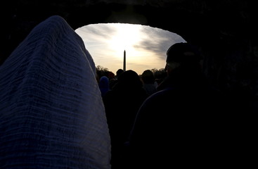 """Participants in an Easter Sunday sunrise Christian religious service pass through a """"Resurrection Gate"""" temporarily installed at the Lincoln Memorial in Washington"""