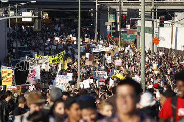 """Protesters march during a general strike called by the """"Occupy Oakland"""" movement in Oakland"""
