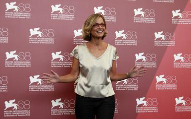 Director  Comencini poses during a photocall for her film Quando La Notte at the 68th Venice Film Festival