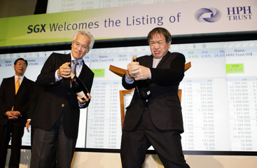 HPHT Chairman Fok and SGX Chairman Chew try to pop champagne bottles during the HPHT's listing ceremony at the SGX in Singapore
