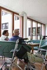 nursing home back shot, a walking frame standing in foreground