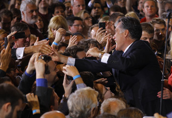 US Republican presidential candidate Romney greets supporters at his Florida primary night rally in Tampa