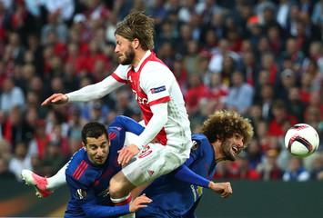 Ajax's Lasse Schone in action with Manchester United's Henrikh Mkhitaryan and Marouane Fellaini