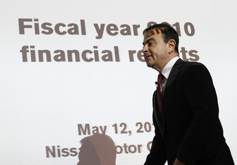 Nissan Chief Executive Carlos Ghosn arrives at a news conference in Yokohama