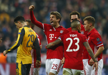 Bayern Munich's Thomas Muller celebrates scoring their fifth goal with teammates