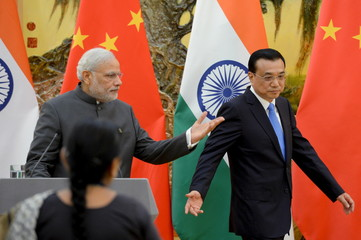 Indian Prime Minister Modi and Chinese Premier Li prepare to give a speech during a news conference at the Great Hall of the People in Beijing