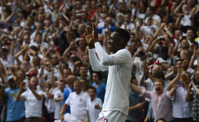 England's Welbeck celebrates scoring a goal against Belgium during their international friendly soccer match in London