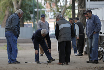 Retired men play at a public park in Buenos Aires