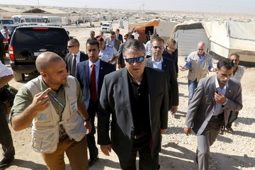 German Economy Minister Sigmar Gabriel listens to a member of the United Nations High Commissioner for Refugees (UNHCR) during his visit to Al Zaatari refugee camp in the Jordanian city of Mafraq