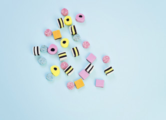 Colored chewing jelly  sweets on the blue background, abstract and minimalism background concept