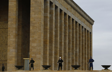 Turkish honour guards stand at attention as Turkey's PM Davutoglu attends a wreath-laying ceremony at Anitkabir in Ankara
