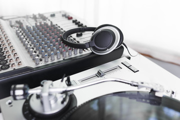 headphones sitting on a mixing board in a recording studio