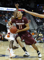 Virginia Tech  Green drives past Clemson Young  in the first half of their ACC college basketball tournament game in Atlanta.