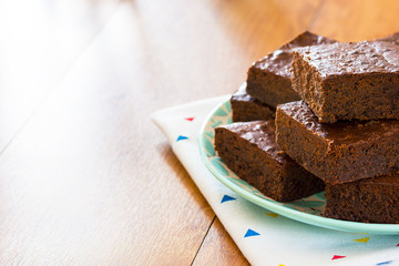 Plate of Chocolate Brownies on Kitchen Table with Copy Space