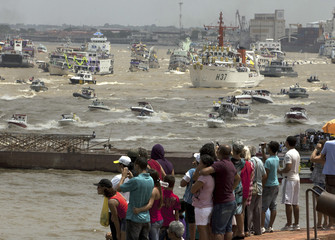 Brazilian Roman Catholic pilgrims converge by boat on the city of Belem to participate in the celebration of the Cirio de Nazare