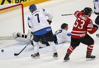 Canada's Skinner reacts after scoring past Finland's Maenpaa and goalkeeper Lehtonen during their 2012 IIHF men's ice hockey World Championship game in Helsinki
