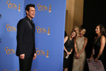 Presenter Jim Carrey poses backstage at the 71st annual Golden Globe Awards in Beverly Hills