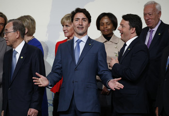 Canadian Prime Minister Trudeau reacts during family photo at the Nuclear Security Summit in Washington