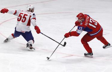 Norway's Tollefsen challenges Russia's Datsyuk during their 2012 IIHF men's ice hockey World Championship game in Stockholm