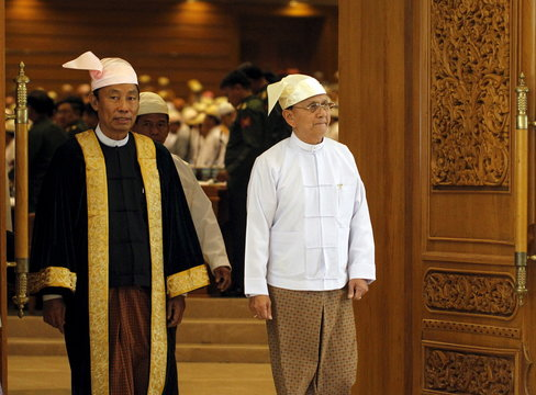 File photo of Shwe Man, Speaker of the Union Parliament, and Myanmar's President Thein Sein exiting after he gave a speech at the regular 9th section of the Union parliament on the final day in Nyapyitaw