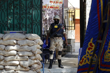 A soldier stands guard at a school that is to serve as a polling station in Cairo