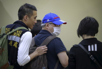 People from Hong Kong arrive at the Institute of Forensic Medicine to confirm if a relative touring in Thailand was a victim of Monday's bomb blast in Bangkok