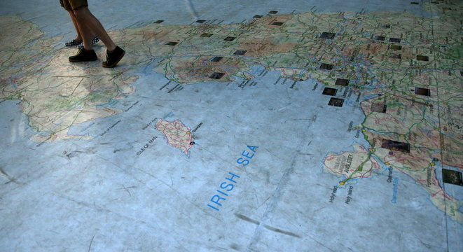People stand on a giant map of The British Isles in Leeds, northern England