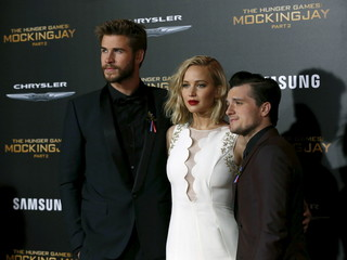 "Cast members Hemsworth, Lawrence and Hutcherson pose at the premiere of ""The Hunger Games: Mockingjay - Part 2"" in Los Angeles"