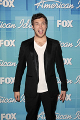 """Winner Phillips poses in the backroom after the 11th season finale of """"American Idol"""" in Los Angeles"""