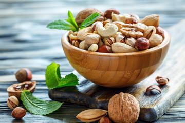 Mix nuts in a bowl closeup.