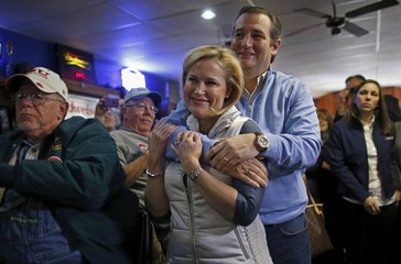 Cruz embraces his wife Heidi during a campaign event in Ringsted