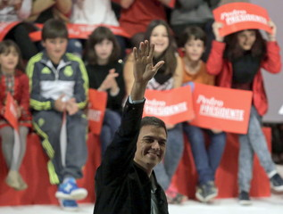 Socialist party (PSOE) leader Pedro Sanchez (L), one of the four leading candidates for Spain's national election, waves during an election campaign rally in Coruna