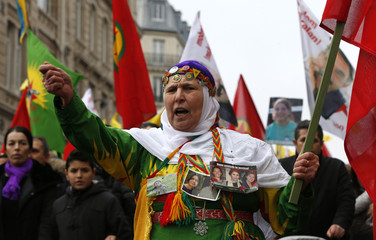 A Pro-Kurdish protester attends a demonstration called European Demonstration March For Truth And Justice in Paris