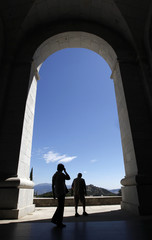 Visitors walk through the arches of the El Valle de los Caidos (The Valley of the Fallen), the  giant mausoleum holding the remains of dictator Francisco Franco, in Madrid