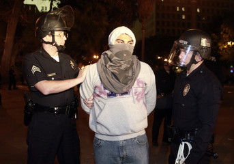 Los Angeles Police Department officers arrest an Occupy LA protester at the encampment at LA city hall