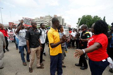 Protesters of Bring Back Our Girls campaign group (BBOG) take part in a protest at the entrance to the presidential villa in Abuja